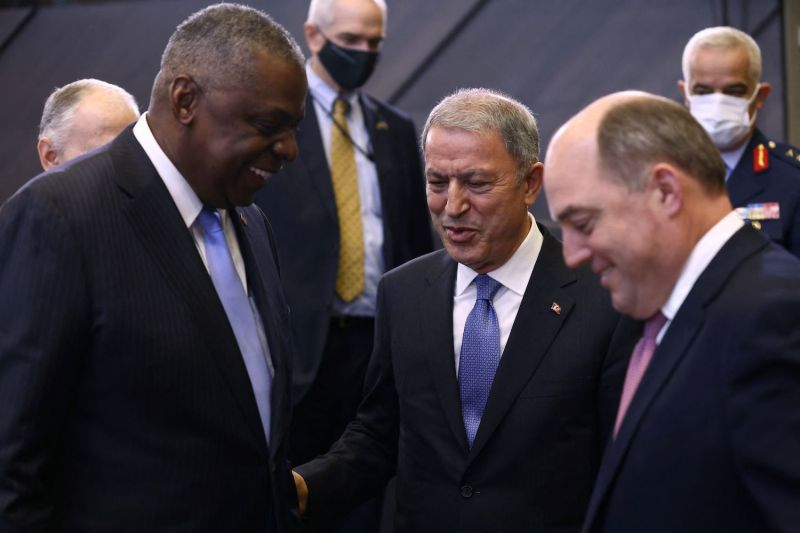 Defense ministers talk at NATO meeting.