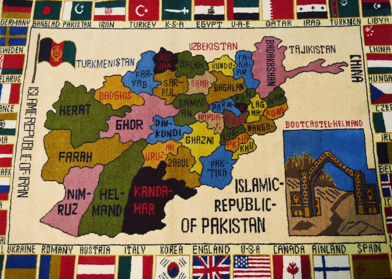 A carpet bearing images of a map of Afghanistan and flags of different countries is pictured inside a shop on Chicken Street in Kabul. on Feb 2, 2015.