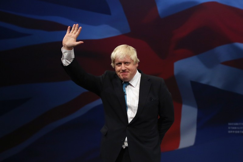 Boris Johnson waves after speaking to conference on the third day of the Conservative party conference on October 6, 2015 in Manchester, England.