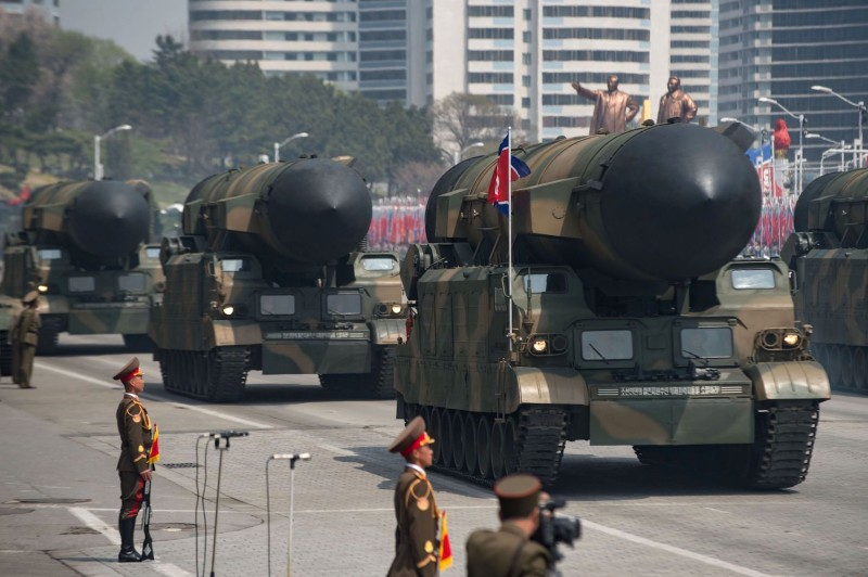 An unidentified rocket is displayed during a military parade.