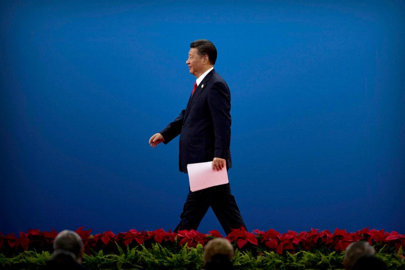 Chinese President Xi Jinping leaves the stage after speaking during the opening ceremony of the Belt and Road Forum in Beijing on May 14, 2017.