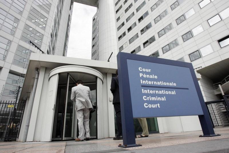 People enter the International Criminal Court in The Hague, Netherlands, on June 20, 2006.