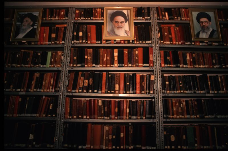 Portraits of Islamic clerics hang in an Iranian library.