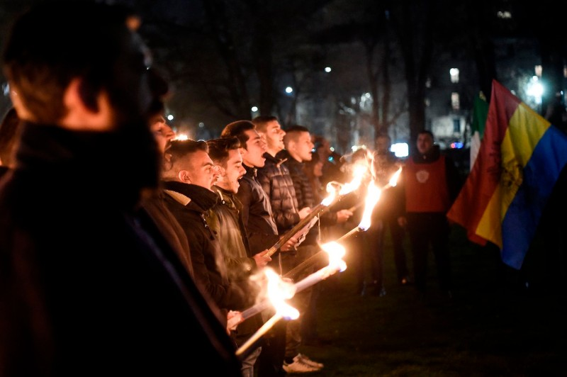 """Members of the far-right movement """"CasaPound"""" hold torches during the Day of Remembrance of the martyrs of the Foibe  on Feb. 10, 2018 in Milan."""