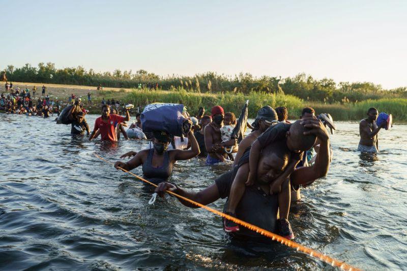 Haitian migrants cross the U.S.-Mexico border on the Rio Grande.