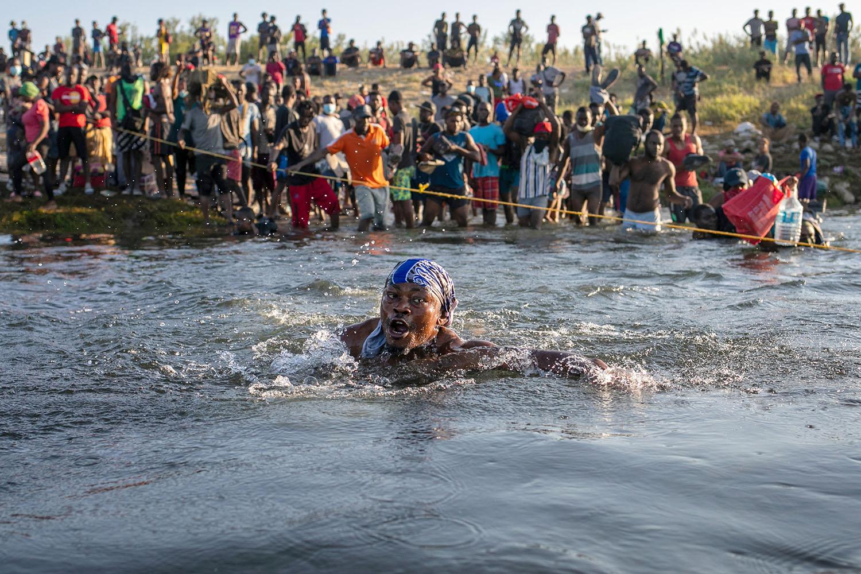 A Haitian migrant crosses the Rio Grande back into Mexico from Del Rio, Texas, in Ciudad Acuna, Mexico, on Sept. 20. John Moore/Getty Images