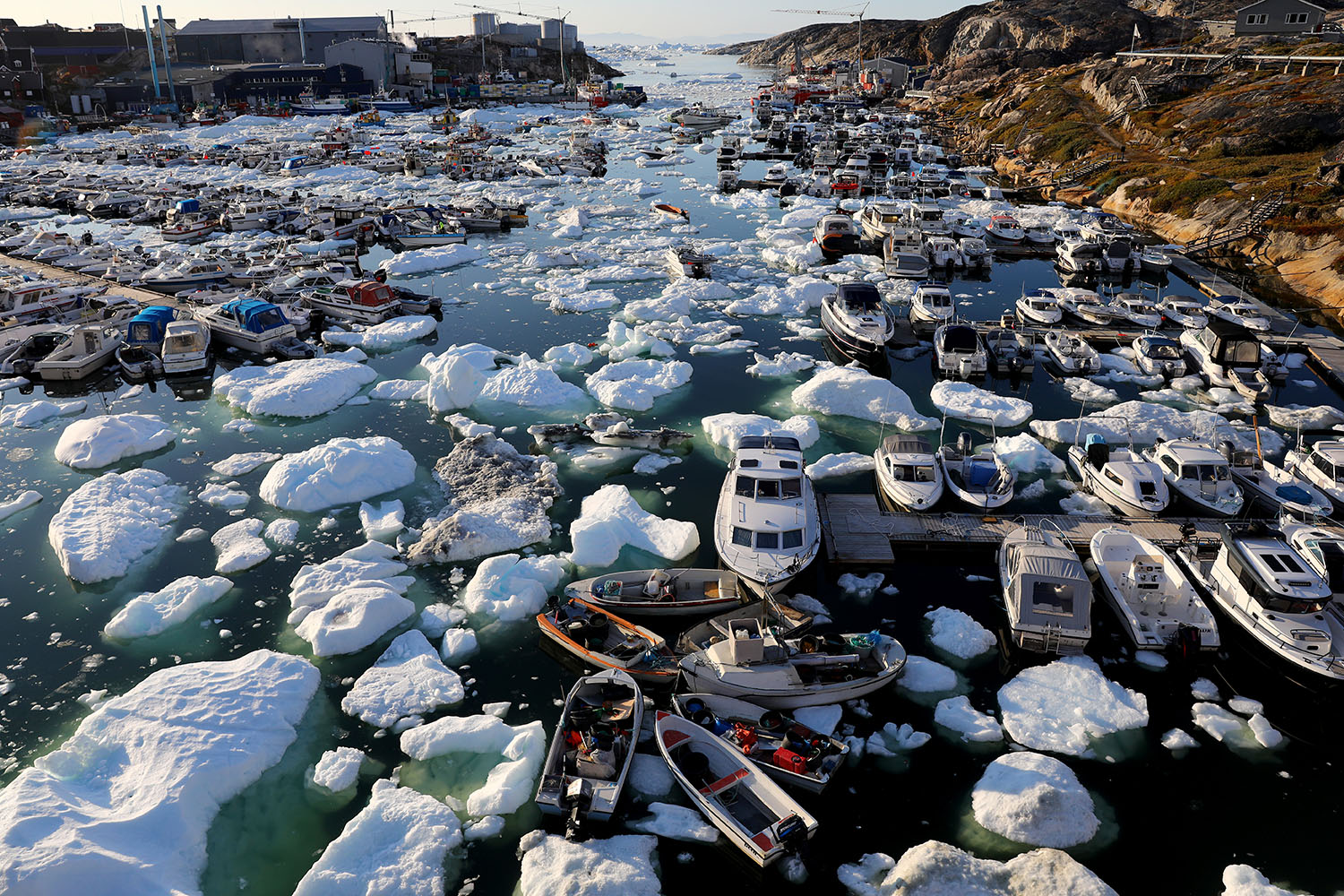 Sea ice floats off a port in Ilulissat, Greenland, on Sept. 2. Mario Tama/Getty Images