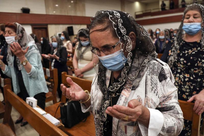 Orthodox Christian worshippers pray.