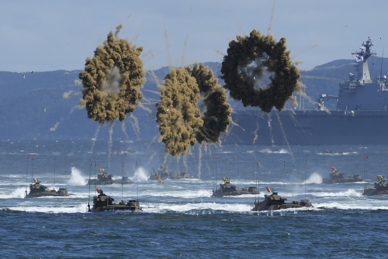 South Korean amphibious assault vehicles sail to shore in a smoke screen landing.