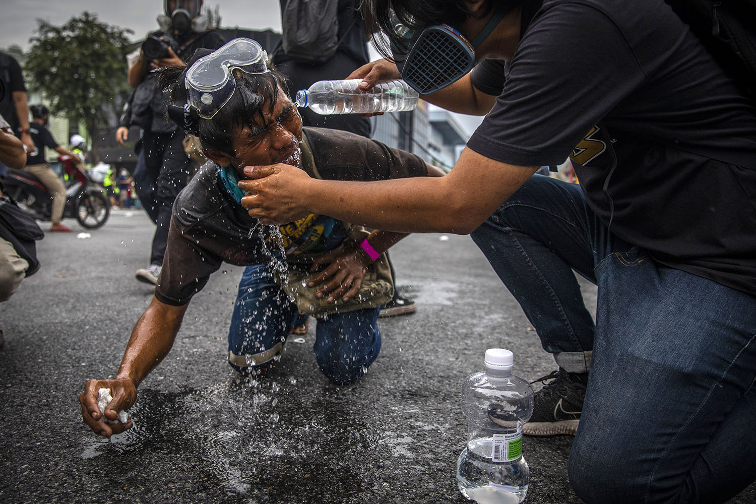 Anti-government protesters have their eyes flushed after being teargassed by Thai police during a rally in Bangkok on Sept. 25. Lauren DeCicca/Getty Images