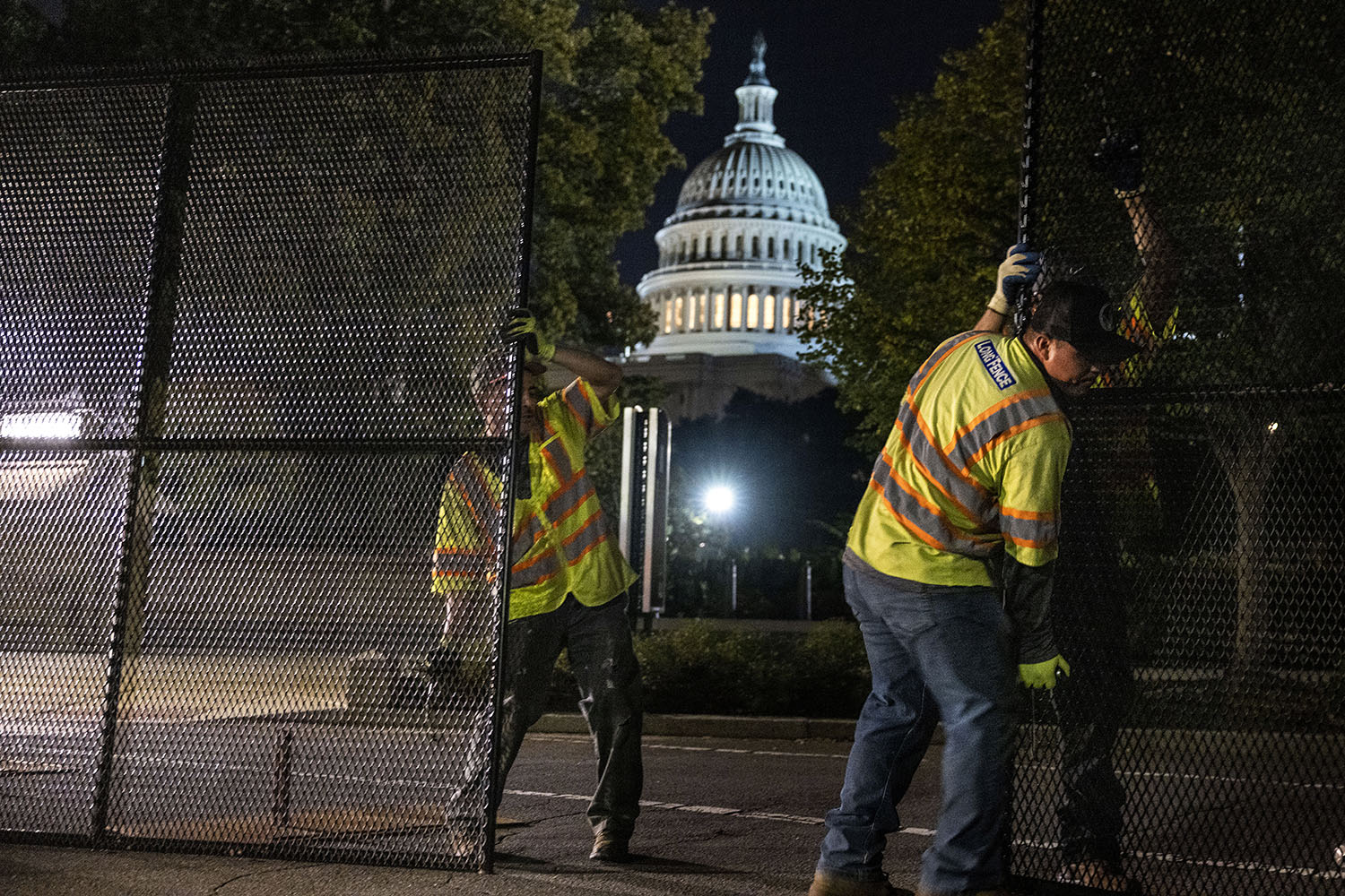 Workers install security fencing around the U.S. Capitol in preparation for the Justice for J6 rally, a far-right protest in support of those jailed in connection to the Jan. 6 attack on the Capitol, in Washington on Sept. 15. Kevin Dietsch/Getty Images