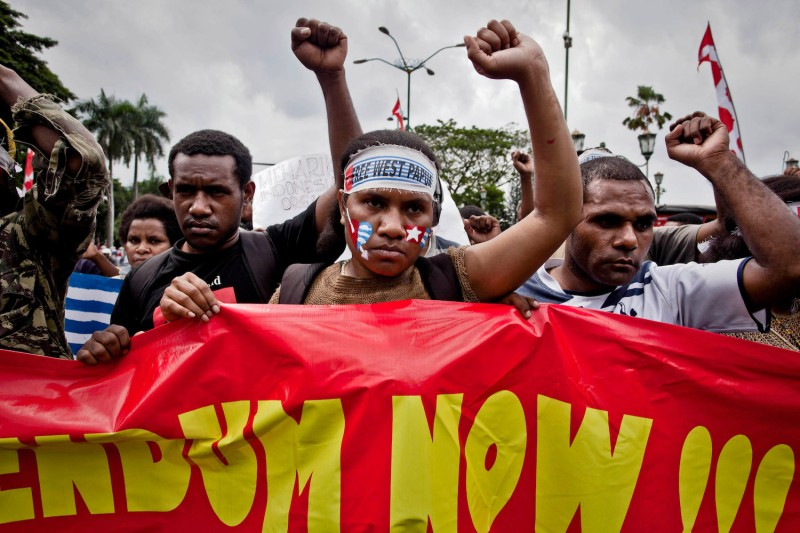 Members of the Papuan Students Alliance protest in support of the Papuan independence movement.