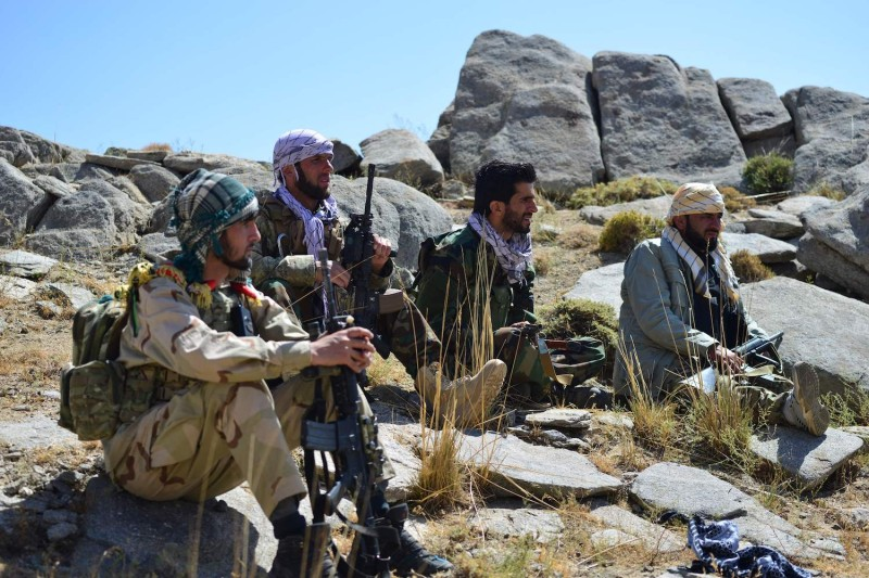 Afghan resistance movement and anti-Taliban uprising forces take rest as they patrol on a hilltop in Darband area in Anaba district, Panjshir province on Sept. 1, 2021.