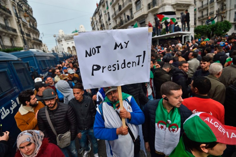 Algerians take part in a protest rejecting the results of a widely boycotted vote that brought Abdelmadjid Tebboune, a former ally of deposed Algerian leader Abdelaziz Bouteflika, to power in Algiers on Dec. 13, 2019.