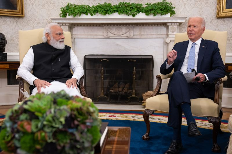 Modi and Biden sit next to each other in the White House.