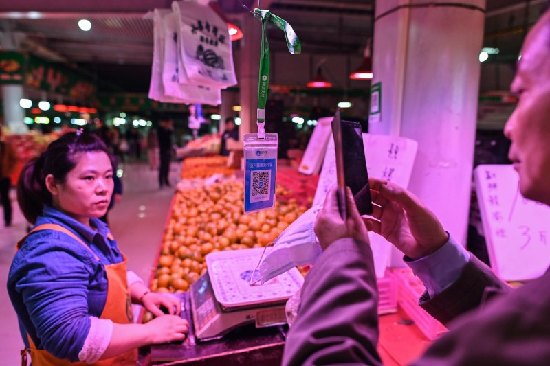A customer scans the Alipay QR payment code at a market in Shanghai on Oct. 27, 2020.