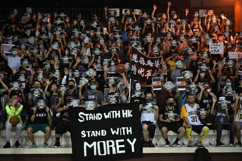Protesters shout slogans as they hold flyers in Hong Kong on October 15, 2019, during a rally in support of NBA basketball Rockets general manager Daryl Morey.