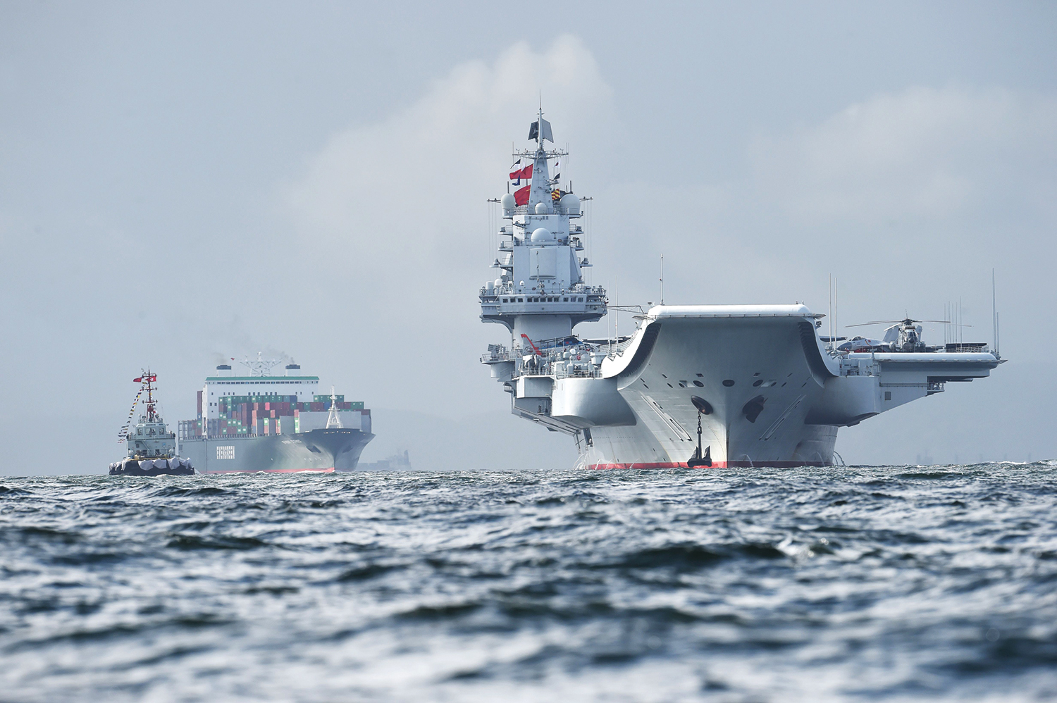China's first aircraft carrier, the Liaoning (right), arrives in the waters off Hong Kong.