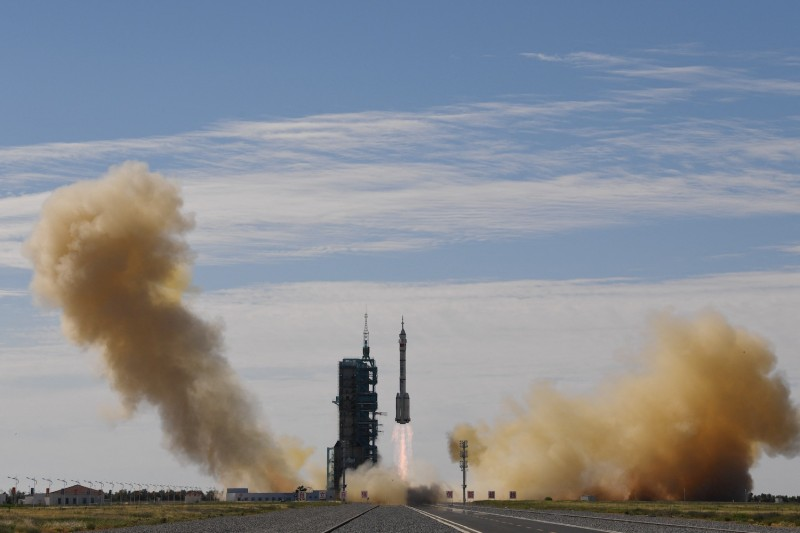 A Long March rocket carries the Shenzhou 12 to orbit.