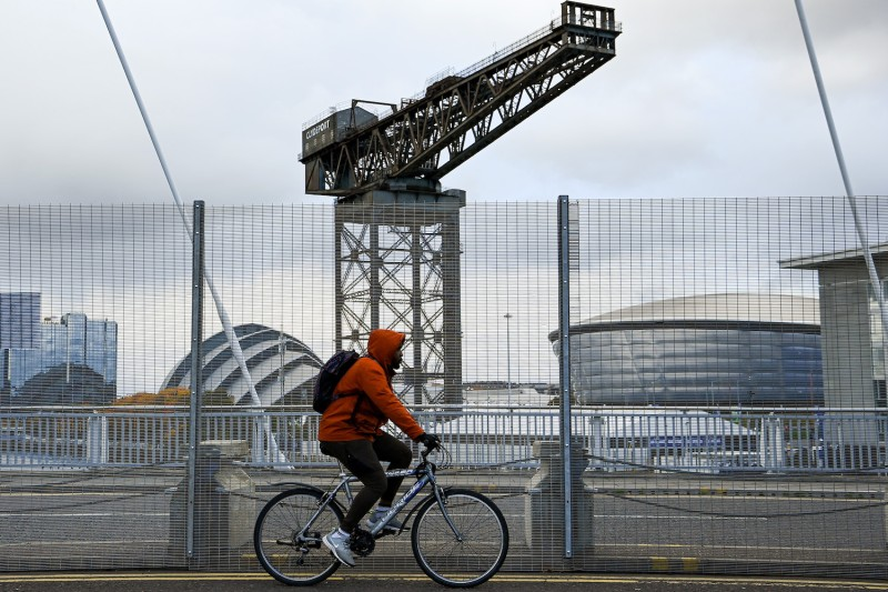 People make their way over the Clyde Arc Bridge following road closures ahead of the COP26 climate summit in Glasgow, Scotland, on Oct. 25.