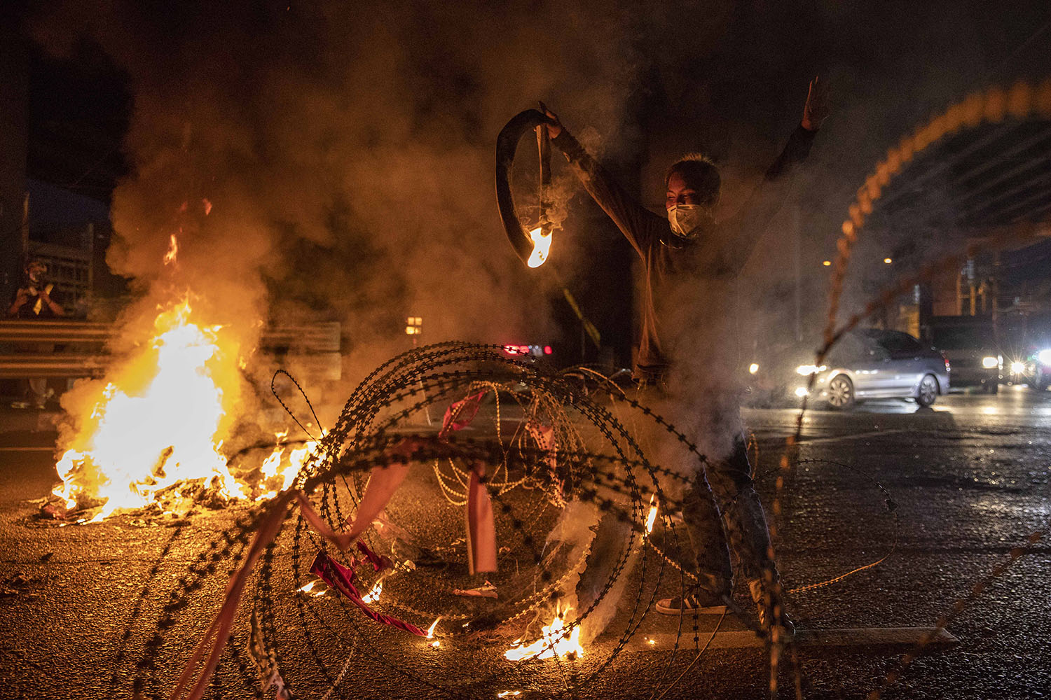 Anti-government protesters light tires on fire during a rally in Bangkok on Sept. 6. Lauren DeCicca/Getty Images