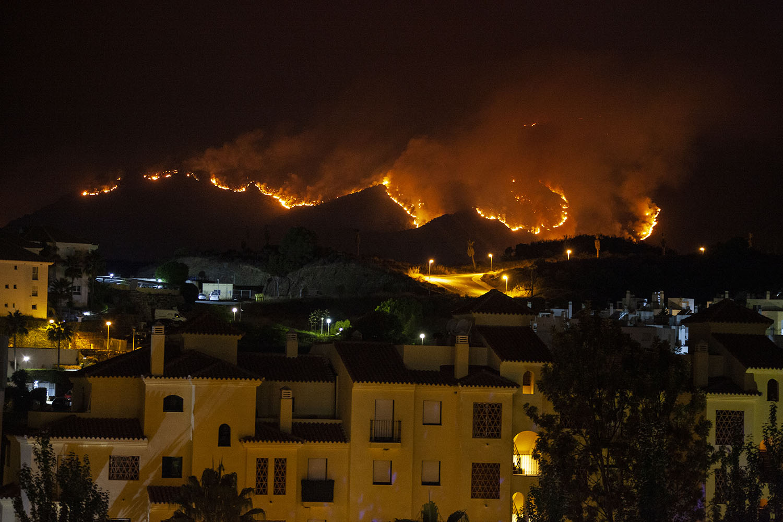 A wildfire of Sierra Bermeja burns through a mountainside in Estepona, Spain, on Sept. 13. Bianca de Vilar/Getty Images
