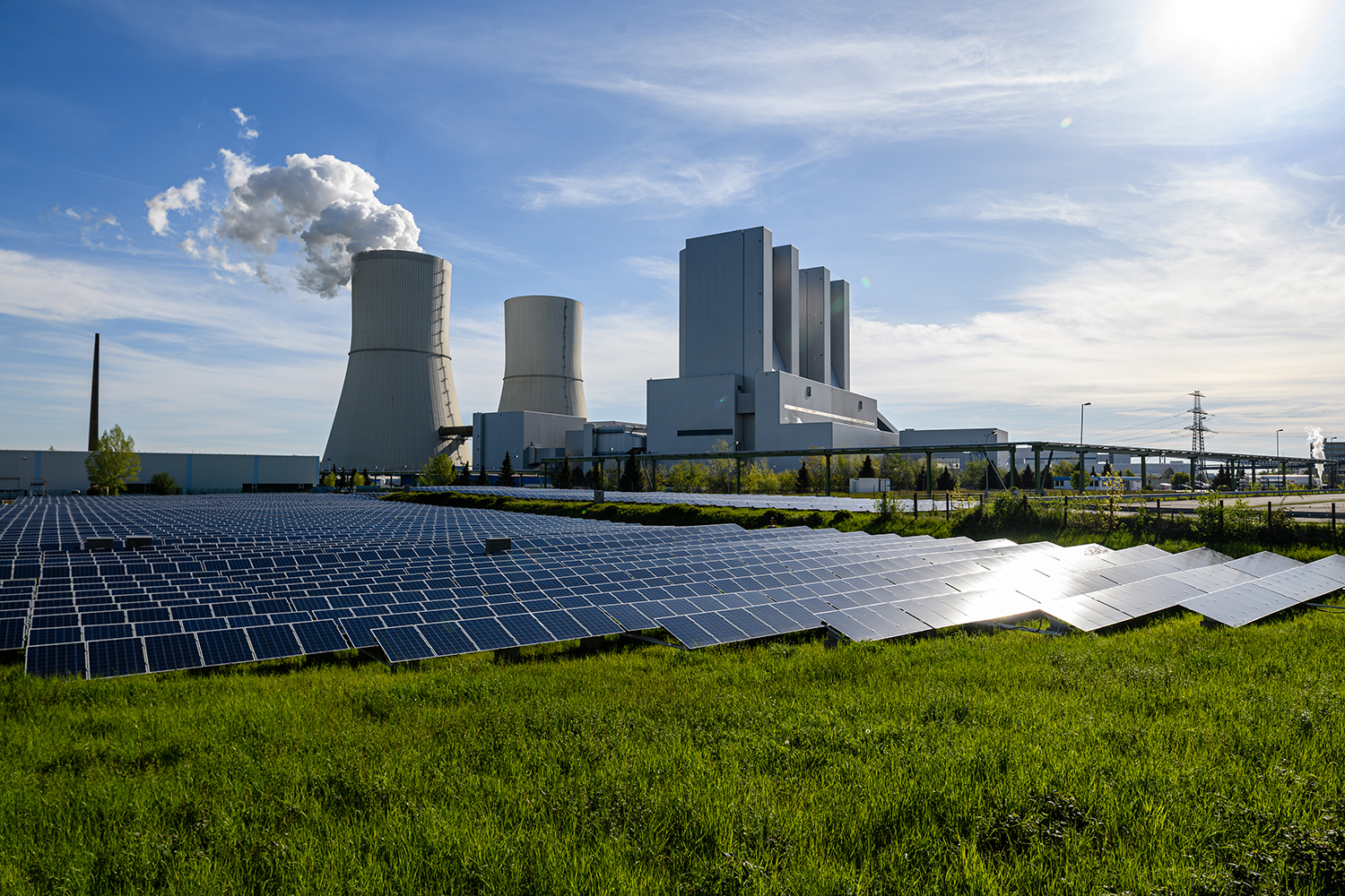 A solar energy field stands next to the Lippendorf coal-fired power plant in Germany.