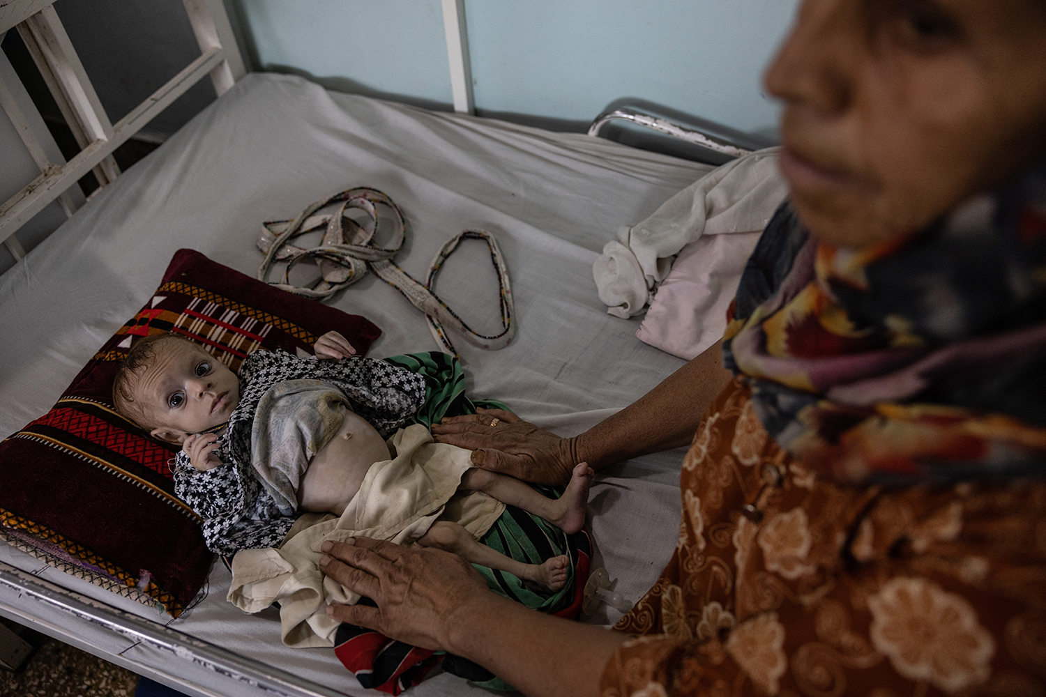 Fifty-year-old Nasanine sits at Mirwais Hopsital in Kandahar with her 7-month-old granddaughter, Setara, on Sept. 25.