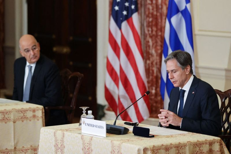 Greek Foreign Minister Nikos Dendias watches as U.S. Secretary of State Antony Blinken speaks after signing the renewal of a defense cooperation agreement at the State Department in Washington on Oct. 14.