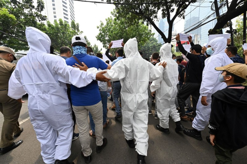Indonesian police disperse protesters.