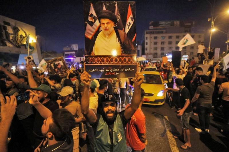 Supporters of Moqtada al-Sadr celebrate in Baghdad.