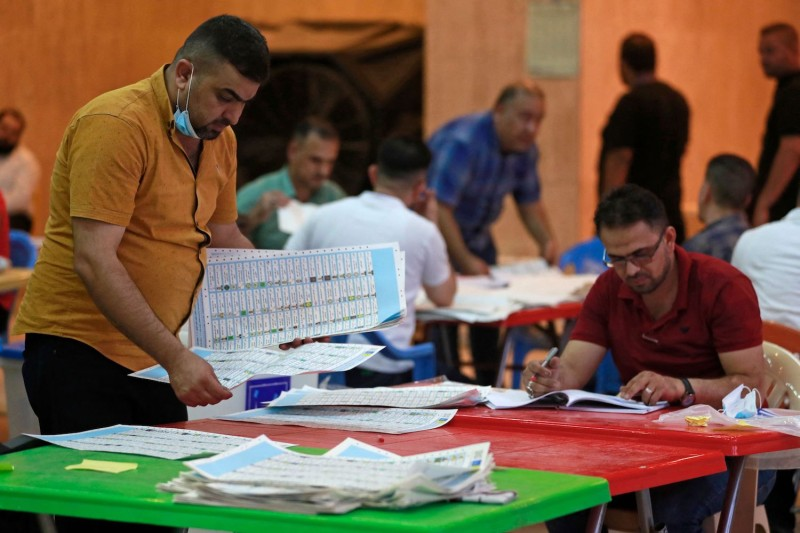 Employees of Iraq's Independent High Electoral Commission count votes