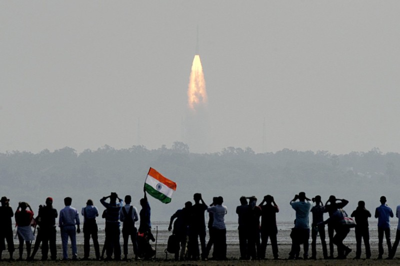 Onlookers watch the launch of an Indian Space Research Organisation rocket from the Satish Dhawan Space Centre at Sriharikota on Feb. 15, 2017.