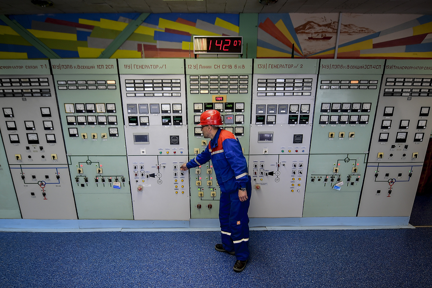 A worker staffs the control room at a power plant owned by RusHydro.