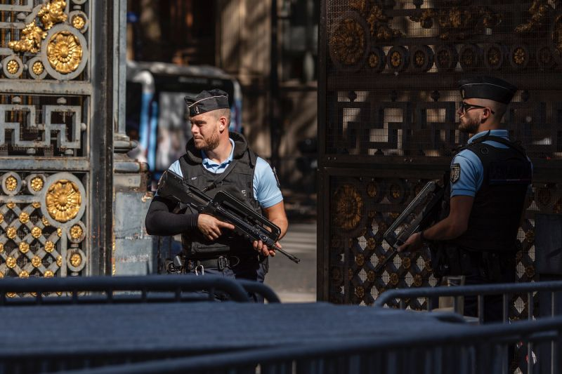 French Gendarmerie stand guard by the main gates of the Palais de Justice, where the trial of the alleged perpetrators of the November 2015 Paris terrorist attacks is taking place, in Paris on Sept. 7.