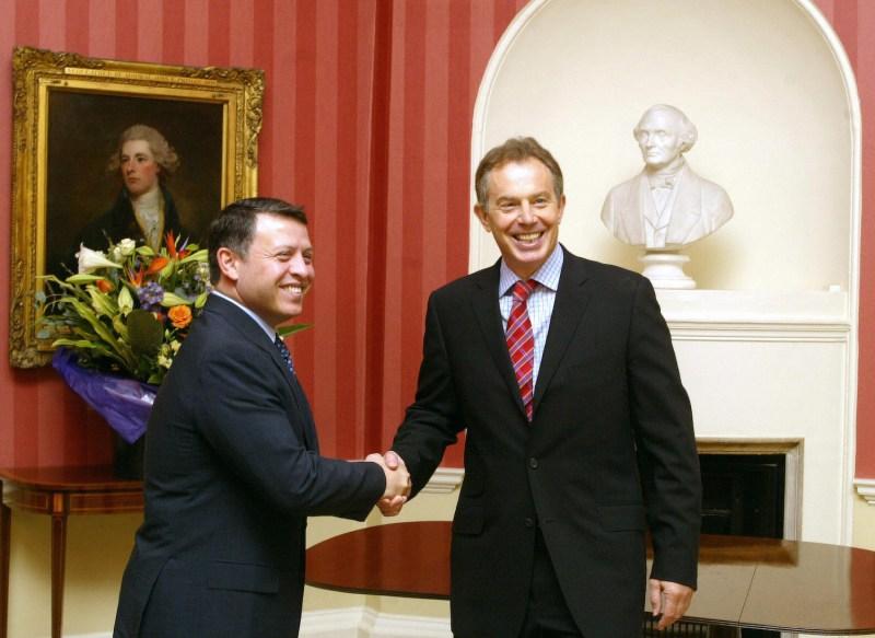 Then-British Prime Minister Tony Blair greets Jordanian King Abdullah II.
