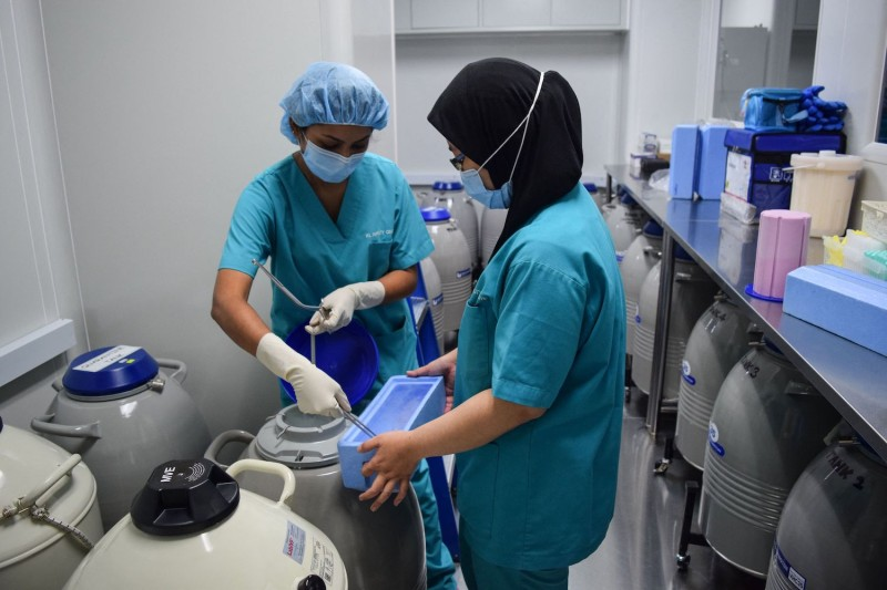 Staff at the KL Fertility Centre demonstrate the egg freezing procedure for members of the media in Kuala Lumpur, Malaysia, on May 11. A growing number of women in Singapore are traveling overseas to clinics such as this one to freeze their eggs.