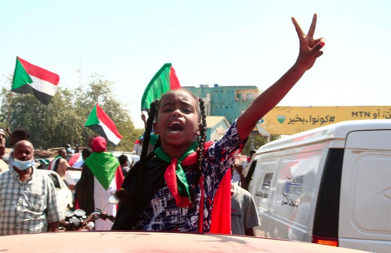 A young Sudanese girl takes part in a demonstration.
