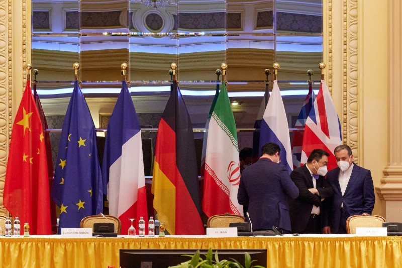 Then-Iranian Deputy Foreign Minister Abbas Araghchi (R) speaks with other participants at the Iran nuclear talks on Apr. 27, 2021 in Vienna, Austria.